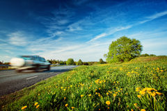 Car on asphalt road in beautiful summer evening Stock Image