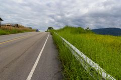 A car on rural road ahead to the mountain Royalty Free Stock Photography