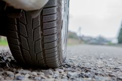 Car on asphalt road in spring morning.  stock photography