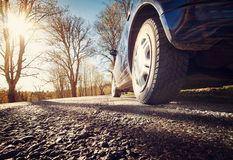Car on asphalt road in spring morning Royalty Free Stock Photos