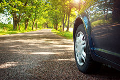 Car on asphalt road in summer Royalty Free Stock Image