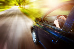 Car on asphalt road in summer Royalty Free Stock Photos