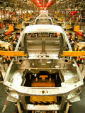 Car assembly line. Cab assembly in line process Royalty Free Stock Photo