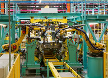 Car assembly line. Interior of modern automated assembly line for cars in during operation Royalty Free Stock Images