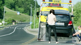 Car assistance help setting the broken car stock video