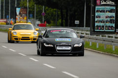 CAR AUDI R8 AND PORSHE GT3. BELGRADE-JUNE 26 : CITY OF BELGRADE 24h RACE,500km PREMIERE EDITION,CAR AUDI R8 AND PORSCHE GT3 on work out driving,JUNE 26, 2010 in Royalty Free Stock Photos