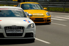 CAR AUDI TT SPORT AND PORSHE GT3. BELGRADE-JUNE 26 : CITY OF BELGRADE 24h RACE,500km PREMIERE EDITION,CAR AUDI T T SPORT and PORSCHE GT3 on work out driving,JUNE Royalty Free Stock Photo