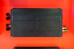 Car audio amplifier isolated on red background royalty free stock image