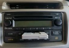 Car Audio with Cassette Tape on it. A Car Audio with Cassette Tape on it stock image