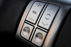 Car audio control buttons. On a steering wheel royalty free stock image