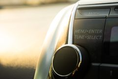 Car audio menu button. With warm light royalty free stock image