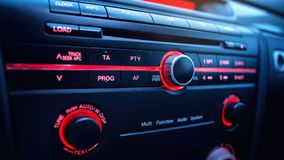 Car audio system. Button on dashboard in modern car panel. Car radio and air conditioner system. Button on dashboard in modern car panel. Navigation in car Royalty Free Stock Photo