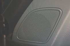 Car audio system close up honeycomb in front door panel. Car radio speaker stock photos