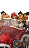 CAR AUTO. One red car toy with 5 toy  friends Royalty Free Stock Photos