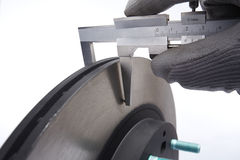 Car Auto Brake Parts. Brake disc of a car by checked for wear stock photos