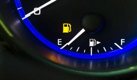 Car auto dashboard fuel gauge showing out of gas empty fuel tank. Close-up detail of car auto dashboard gas fuel gauge indicating showing empty fuel tank out of stock photography