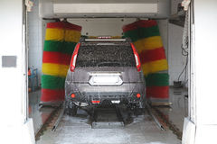 The car in an automatic car wash. Stock Images