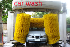 Car in Automatic Car Wash. Photo of a frontal view of a car standing in an automatic car wash Royalty Free Stock Photos