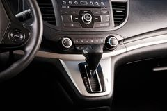 Car automatic gear. Stick close up view with dashboard stock images