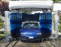 Car in Automatic Washing. A car is washed in automatic washing with roller royalty free stock images