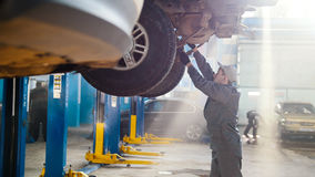 Car automobile service - mechanic checks the luxury SUV Royalty Free Stock Image
