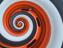 Car automobile wheel rim tire spiral abstract fractal background. Orange wheel rim spiral effect pattern abstract background. Auto Stock Photos