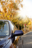 Car on autumn's road. Close-up of the car is driving on autumn's road Stock Photo