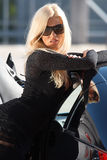 Car and babe. Glamorous blond babe standing near tuned supercar stock photos