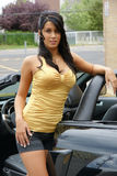 Car and babe. Babe standing in side of mustang shelby gth with top down stock images