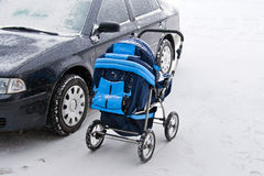 Car and baby\'s pram on parking Stock Photos