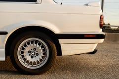 Car back wheel. Back wheel of a white car on sunset Stock Image