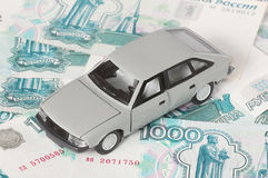 Car on background of money. Car is on background of Russian money Stock Images