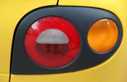 Car Backlight. Yellow Car stop-light and winker Stock Photo