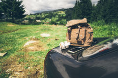 Car with backpack on the trunk Stock Images