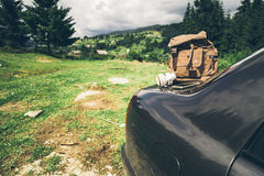 Car with backpack on the trunk Stock Image