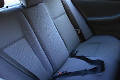 Car backseat. Family car grey backseat and seat belt stock photo
