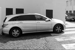 Car Badly Parked on Pedestrian-Crossing. A car badly parked on a pedestrian crossing, in Lisbon, Portugal Royalty Free Stock Image