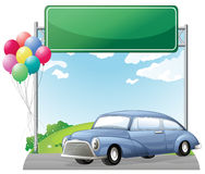 A car and balloons with an empty signboard Stock Photo