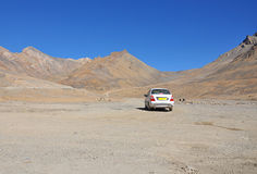 Car in barren mountains Royalty Free Stock Photos