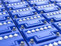 Car batteries background. Blue accumulators. Royalty Free Stock Photography