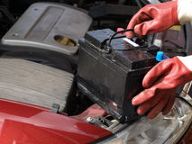 Car battery. Changing battery in the car royalty free stock photo