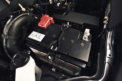 Car battery. In the engine room Royalty Free Stock Photo