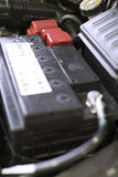 Car battery. Installed on the car Stock Images