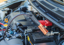 The car battery with jumper cable in engine room Stock Image