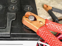Car battery jumper cable. Red copper clamp with jumper cable for car battery charging, selective focus Royalty Free Stock Photos