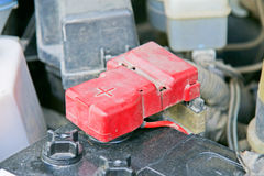 Car battery with red positive polarity (Selective focus) Stock Images