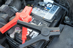 Car battery. And starter booster cable stock photography
