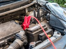 Car battery with two jumper cables Stock Photos