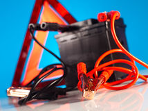Car battery with two jumper cables clipped on vivid moto concept Royalty Free Stock Image