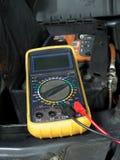 Car battery voltage checking Royalty Free Stock Photos